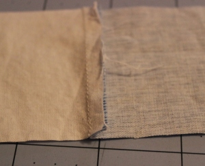 Seams pressed to the darker fabric.