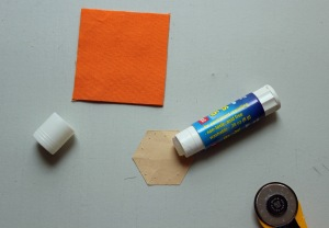 Add a dap of glue to your paper hexagon (this is 7/8