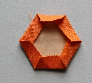 Press the hexagon with an iron.